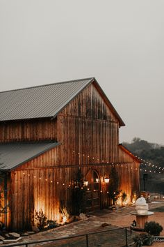 Look no further for a country wedding venue than a massive barn set in the woods. Bistro lighting and soft uplighting along the perimeter make it glow with romance. wedding venue 25 Old-Fashioned Country Wedding Ideas Wedding Reception Ideas, Barn Wedding Decorations, Barn Wedding Venue, Farm Wedding, Dream Wedding, Budget Wedding, Luxury Wedding, Elegant Wedding, Barn Wedding Lighting