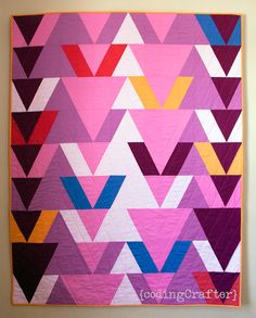 The Quilt Design a Day (QDAD) project, started by Anne Sullivan, was a challenge to design a new quilt every day based on a provided inspiration image and color palette. The Facebook group has quic…
