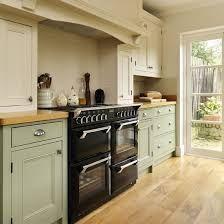 Sage Green Kitchen Walls With Cream Cabinets