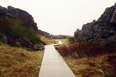 Iceland. Where in Þingvillir, a beautiful wooden path, leads to the Öxarárfoss waterfall.