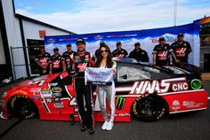 Kurt Busch, #41 Haas Automation Chevrolet, left, poses with Miss Coors Light Amanda Mertz and the Coors Light Pole Award after qualifying for the pole for the NASCAR Sprint Cup Series Axalta 'We Paint Winners' 400 at Pocono Raceway.