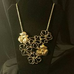 Shimmering and beautiful. . Gold tone flowers statement necklace. Jewelry Necklaces