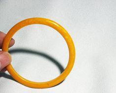 Your place to buy and sell all things handmade Bangle Bracelets, Bangles, Color Themes, Mustard Yellow, Jewelry Collection, Vintage Jewelry, Great Gifts, Plastic, Cabinet