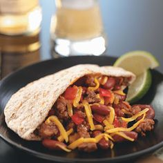 "Hearty Pita Tacos Recipe -""You don't need to skimp on flavor when trying to eat healthy. Our daughter enjoys helping us make these tasty tacos and enjoys eating them even more. I Love Food, Good Food, Yummy Food, Pita Recipes, Healthy Recipes, Healthy Foods, Yummy Recipes, Tapas, Pita Pockets"
