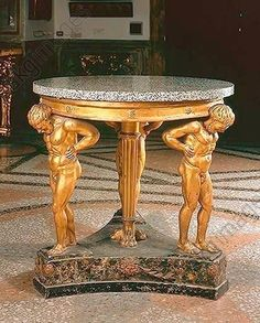 Round table with Atlantes / Rome 1810 Table plate granite, base wood, gilded. Rome, Galleria Corsini.