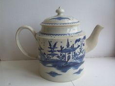 "Liverpool Pearlware 18thc Blue & White Teapot,Pot measures: 8"" handle to spout & 61/2"" high. Condition: fair for age, it has a restored spout, which has been restored well. A little fine crazing, as a Teapot this old may well have. There is good restoration to inside rim of the lid, which isn't noticeable unless looking carefully inside of lid. There is a tiny amount of restoration to very tip of lid knob 60.00"