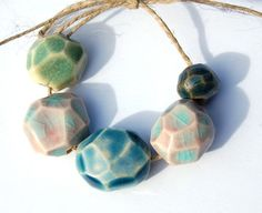 Glazed Beads. Same technique with glazing. White beads with a glaze in a summer color like coral or yellow would be pretty.