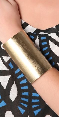 Love the idea of a thick, gold wrist cuff