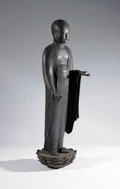 centuriespast: Jizo Bosatsu (Ksitigarbha) JapanThis image was never painted or gilded, the only surface decoration being the marks of the sculptor's chisel. His right hand originally held a walking stick and his left a jewel, symbolic of his ability to answer all sincere pleas for help.Birmingham Museum of Art