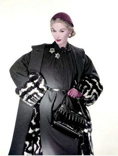 1951 Lisa Fonssagrives in gray wool dress worn with civet fur-lined coat, photo by Erwin Blumenfeld