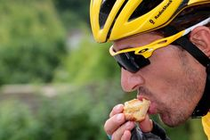 Switzerland's Fabian Cancellara eats as he rides in the sixth stage on July 6, 2012. (Joel Saget/AFP/GettyImages)