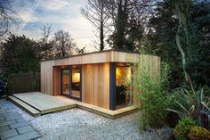 What is it about garden rooms that is so universally appealing? We're getting excited just thinking about the prospect of a seclude little spot somewhere, like this wooden eco garden room with a green roof.