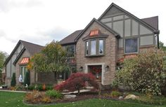 Hardie tudor siding in Northville - traditional - exterior - detroit - by 21st Century Building Company