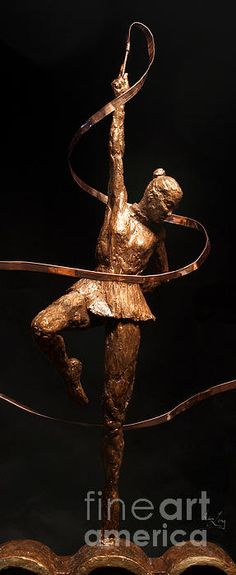 """A detail photo of the female Gymnast in this sculpture finalist in the 2012 United States Olympic Art Competition about Excellence and Friendship in the Olympic Games created from steel-reinforced Hydrostone with bronze patina and copper measuring 24"""" x 25"""" x 5"""" by Adam Long (this work is also available as a limited edition bronze)."""