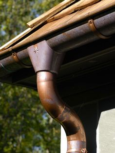 Weathered copper rain gutter and downspout