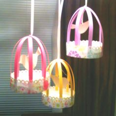 Paper birdcages for K's 1st bday party!