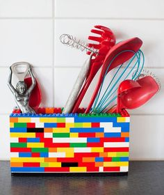 I'm always looking for ways to put the fun in functional when it comes to kitchen decor. I have specific storage places for things like measuring spoons and knives, but I'm thinking I could loosen up a little and bust out one of these DIY LEGO utensil holders!