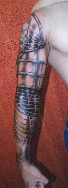 Suit of Armor Arm Tattoo by Mike Bellamy #tattoo #armor #suitofarmor #sleeve http://tattoopics.org/suit-of-armor-arm-tattoo-by-mike-bellamy/