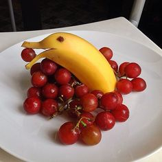 What a great idea for children/school snack!  Banana dolphin, individual small containers, surrounded  supported by red  green grapes!