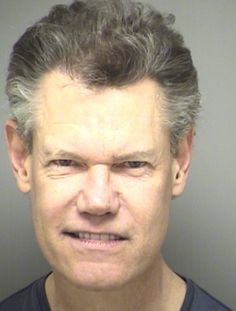 Country singer Randy Travis was arrested by Texas cops in February 2012 and charged with public intoxication, a misdemeanor.  According to Sanger police, Travis, 52, was spotted in a parked vehicle in front of a church with an open bottle of wine.  He was briefly booked into the Denton County jail, where he posed for the above mug shot.