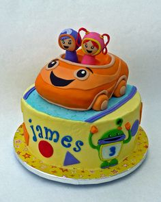 Team Umizoomi - Umi car is sculpted cake MMF covered. The Geo and Millie figures are also MMF wrapped around a Tootsie Pop!. (Yes I could've cake popped them but timing on a double cake weekend didn't fit so we used an alternative) The base cake is BCF with MMF details.