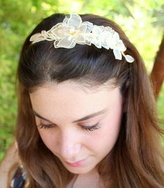 Bridal lace Elegant Hairband cream color with Swarovski pearls   Gold plated tiara with perfect cream floral lace applications   Has an adjustable gold coated headband .  You can wear it for everyday or for your any special accession . You can wear it as a tiara with a veil or as headband.  Please notice shipment policies , the item can be sent by Ems express international for more details please convo me .  Item will be sent in a jewelry gift box with ribbon, shipped within 48 hours…