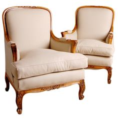 Pair of French Carved Walnut Bergeres | From a unique collection of antique and modern bergere chairs at http://www.1stdibs.com/seating/bergere-chairs/