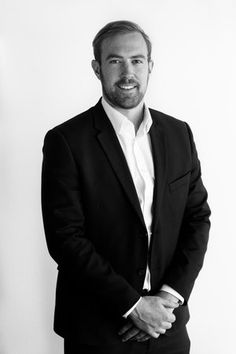 Black and white 3/4 length corporate portrait in office using natural light.