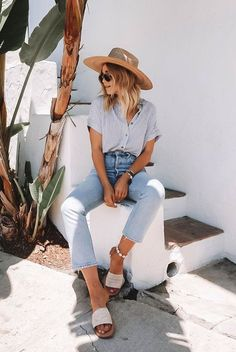 Fashion Blogger Blonde Collective wearing a stripe short sleeve shirt, high waist jeans, beige slide sandals, a straw hat and round sunglasses. Summer outfit, vacation outfit, casual outfit, beach outfit, summer style, summer vacation outfit, summer fashion trends 2019, comfy outfit, travel outfit, #fashion2019 #summerstyle #vacationstyle #casualstyle #summertrends2019