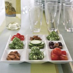 Feta Cheese Truffles, Serve Feta Cheese Truffles with cucumbers, tomatoes, almonds, and olives. For lighter truffles, use low fat feta and cream cheese.
