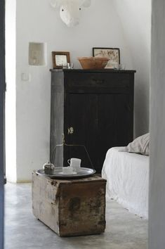 vintage cabinet and trunk making a statement