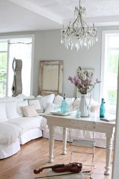 white slip covered sofas with gray walls