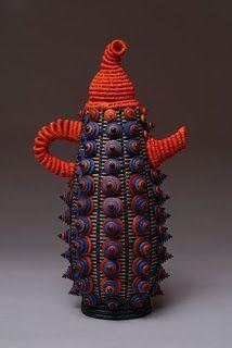 Orange Zipper Teapot, 2007  Black Ash, Beads, Waxed Linen,  Wire, Fiber Cord, Zipper, Thread  By JoAnne Russo