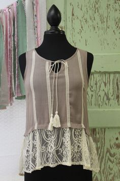 This is a very cute light mocha top. Sleeveless woven top with crochet tape and…