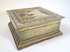 """Wood box Lorenzo Lotto  Wooden case decorated, obtained reusing a box for wines, with addition of profiles and wooden frames for furniture, chalk priming, drawing color and processes of aging of the surface, cover with landscape painting oil  This case, by researched classical forms, presents on the upper part a painting oil, drawn freely from the original painting """"Susanna and the Elders """"of 1517, by Lorenzo Lotto.   #madeinitaly #artigianato #crafts #italy"""