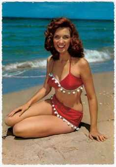 Love her hair, as well as the playful pompom fringe on her suit. #summer #beach #pinup #vintage #1950s #1960s
