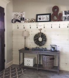 Entry way  Free plans to build the table and planked wall and shelf are on our site.. Shanty 2 chic