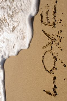 I love writing words in the sand at the beach