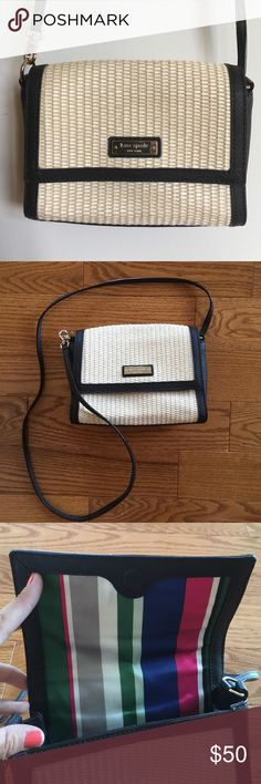 KATE SPADE HAND BAG NWOT. Wicker, tan and black with gold detail Kate Spade hand bag. Colorful interior design with a small side pocket within. Magnetic front clasp. IN MINT CONDITION - NEVER USED! This baby deserves someone who will treat it well, like the quality purse that it is. kate spade Bags Crossbody Bags