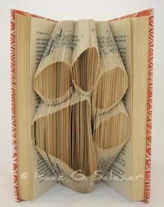 Paw print - recycled book art. What a neat item to display.