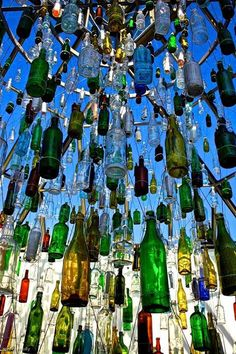 I love that all of the bottles are hanging at different lengths. I also like how they appear to be hanging from a high height because it makes this piece feel open and gives it a wow factor even though there are a lot of bottles kept really close together.