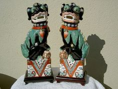 Chinese traditional foo dog pair, but with much more vivid coloration than frequently seen.