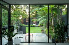 Modern Retro Garden in Leytonstone | 0208 521 9040 Outdoor Paving, Steel Fire Pit, Fiberglass Planters, London Garden, Earth Design, Sofa Styling, Corten Steel, Decorative Panels, Back Doors
