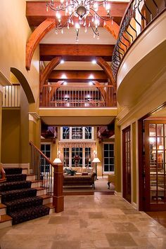 Entry, White beams, light and dark grey walls, dark cheery wood instead of rod iron
