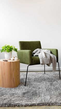 A comfortable and colorful upholstered seat perfectly offsets sleek metal legs. Love this mid-century modern dining armchair from Bryght.