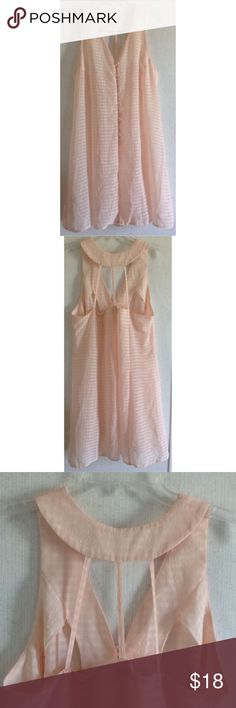 """Caged Back Chiffon Gingham Halter Dress Good condition. A couple spots of a yellow stain near one side. Super cute """"Wan"""" light dress. Semi-sheer chiffon type of fabric with a gingham look woven in. Halter style neck with rounded back. Open caged back. V-neck front. Buttons up the front with a panel underneath. Can fall open where the buttons end. Flares out at the bottom. Pastel peachy pink color. Size large. All offers welcome Wan Dresses Midi"""