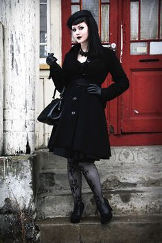 Fall / winter corporate goth with a coat, baret, gloves, heels and leather purse