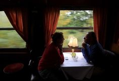 Passengers look out of the window of the restaurant car of a historic Tehran-bound train as it leaves Budapest October 15, 2014. REUTERS/Bernadett Szabo visit http://iranpocketguide.com #Iran #Persia #Tehran #Budapest #TravelToIran #MyIran #Travel2Budapest #MyBudapest