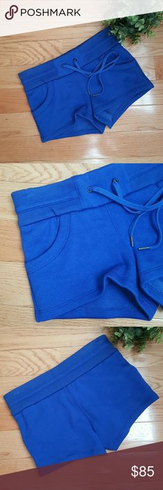 Helmut Lang Fleece Lined Shorts Vibrant cobalt blue shorts- drawstring waist. Size is labled P (petite) which is equivalent to an XS. Please feel free to ask questions.  Offers always welcome! Helmut Lang Shorts