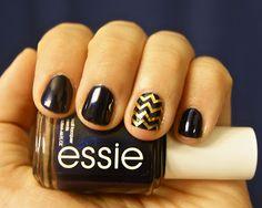 black + gold chevron nails